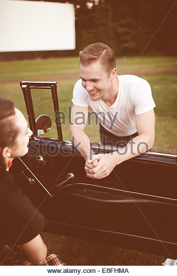 Couple with vintage car - Stock-Bilder