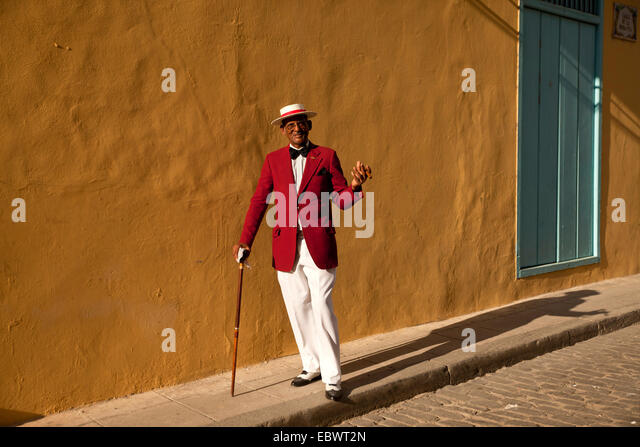 Actor Pedro Pablo Perez wearing a red suit with a hat and a cigar, Havana, Cuba - Stock Image
