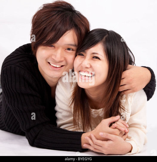 happy young woman and man smiling together - Stock Image