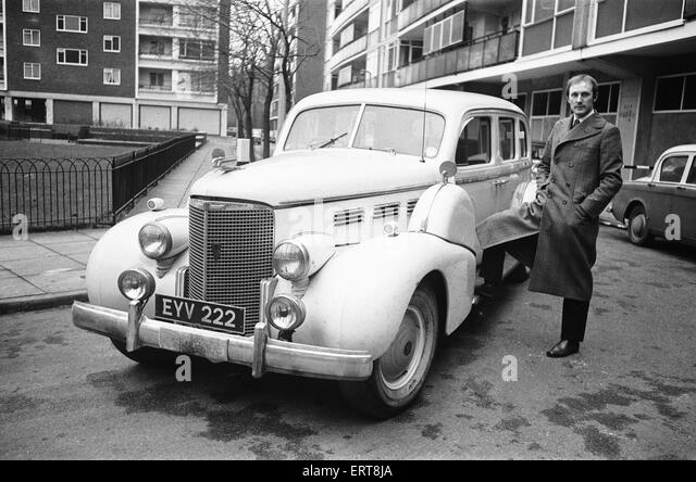 Rupert Lycett Green seen here with his vintage Cadillac. 15th February  1968 - Stock Image