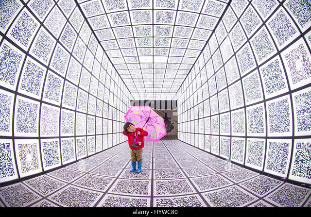 Nanjing, China. 6th Apr, 2017. A creative corridor of QR codes can be seen at a shopping mall in Nanjing, east China's - Stock Image