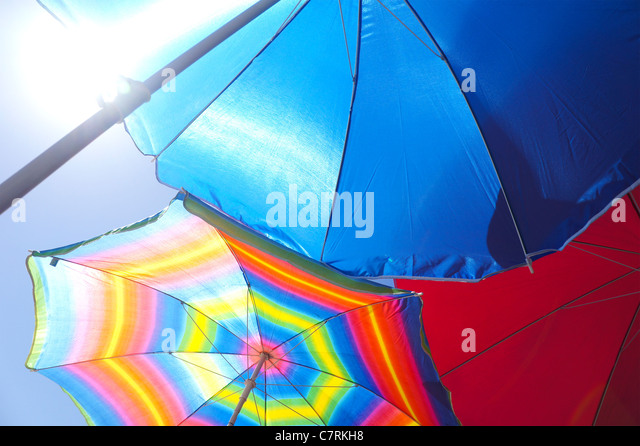 Colourful beach umbrellas - Stock Image