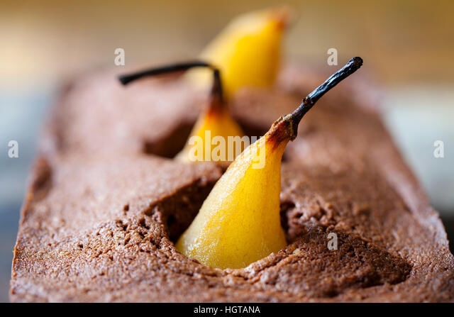 Chocolate sponge cake with poached pear - Stock Image