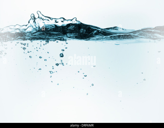 Liquid in container with moving water air bubbles - Stock Image