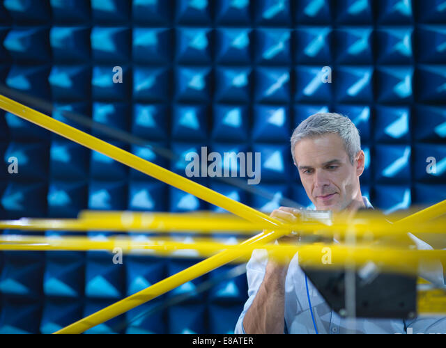 Scientist preparing to measure electromagnetic waves in anechoic chamber, close up - Stock-Bilder