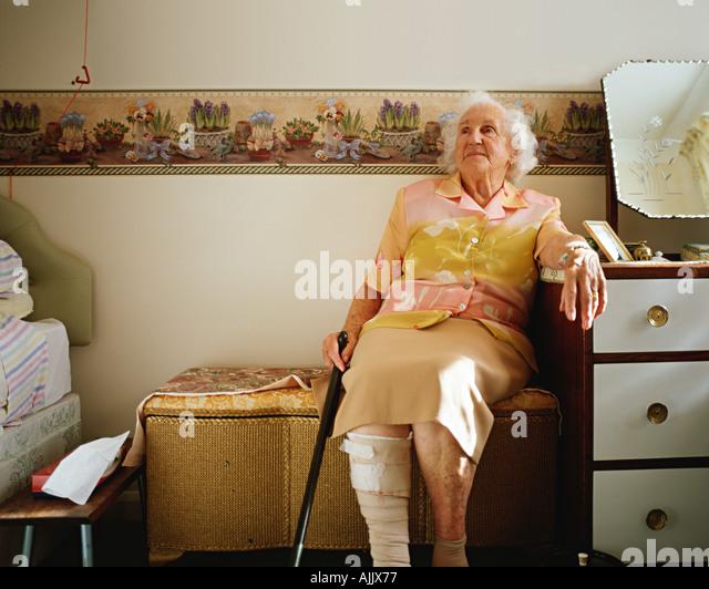 Elderly woman in her room - Stock Image
