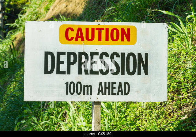 depression ahead caution and warning sign for traffic on road - Stock Image