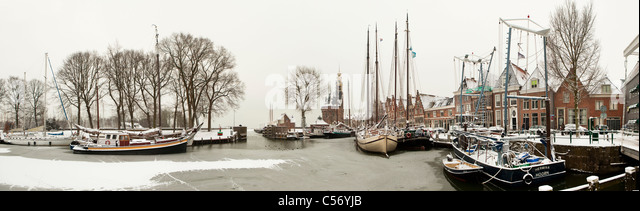 The Netherlands, Hoorn, harbour for traditional sailing boats. Winter, snow. - Stock Image