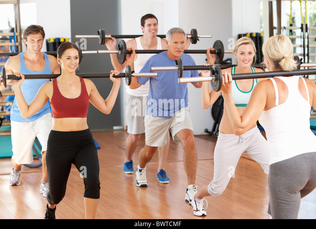 Group, People Lifting Weights In Gym - Stock Image