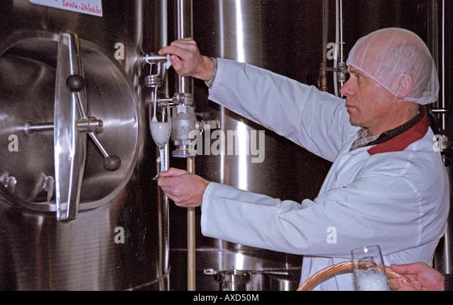 Fermentation tanks. Sampling. Emilio Kunz, oenologist and owner at FANTE of sparkling wine. Vale dos Vinhedos, southern - Stock Image
