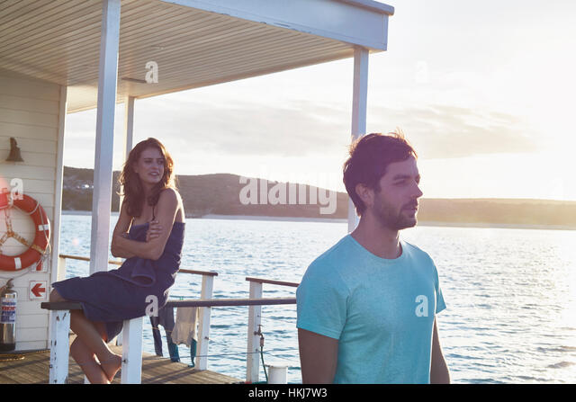 Young couple relaxing on summer houseboat - Stock-Bilder
