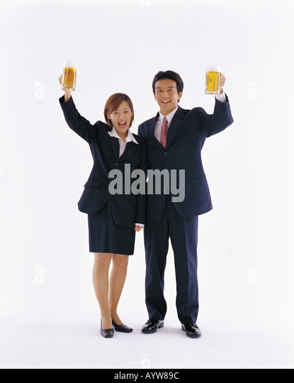 Man and woman office workers with beer in hands - Stock-Bilder