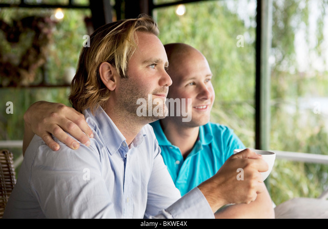Two men looking out the window - Stock Image