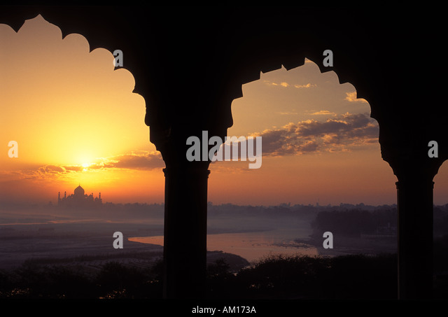 Sunrise over the Taj Mahal from Agra Fort Agra India - Stock Image