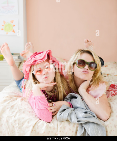 Mother and daughter playing dress up - Stock Image