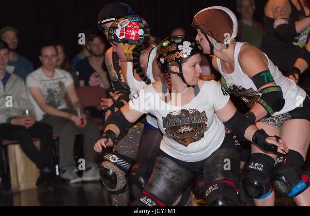 Roller derby skaters blocking - Stock Image