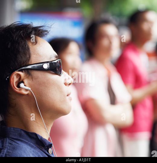 Close-up of a mid adult man listening to music - Stock-Bilder