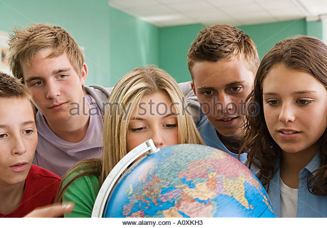School students looking at a globe - Stock Image