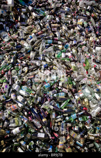 A large group of glass bottles sit ready for recycling in Bend Oregon. - Stock Image
