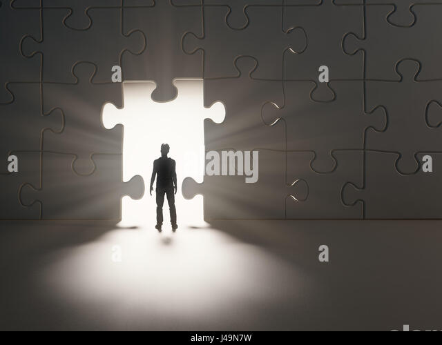 Man walking thourgh a break in a jig-saw puzzle wall - 3D illustration - Stock-Bilder