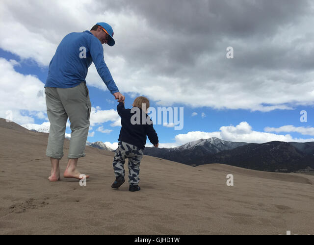 father and son hiking, great sand dunes national park, colorado, america, USA - Stock Image