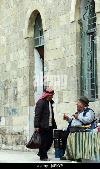Jordanian men chatting in Karameh, Jordan. - Stock Image