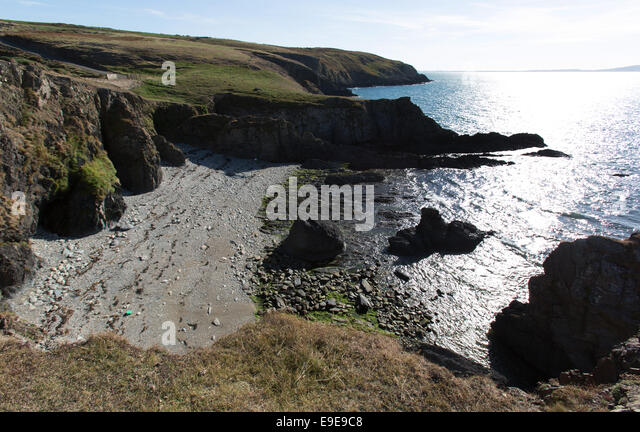 The Wales Coastal Path in North Wales. Picturesque view from the Anglesey west coast section of the Wales Coastal - Stock Image