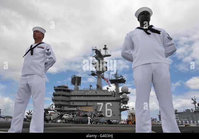Sailors man the rails aboard USS Ronald Reagan. - Stock Image