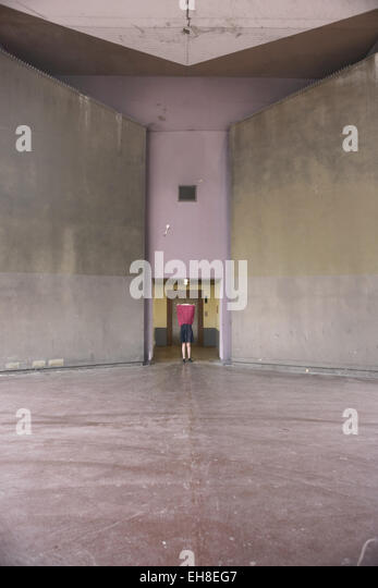 Woman performing on a contemporary urban space. - Stock-Bilder