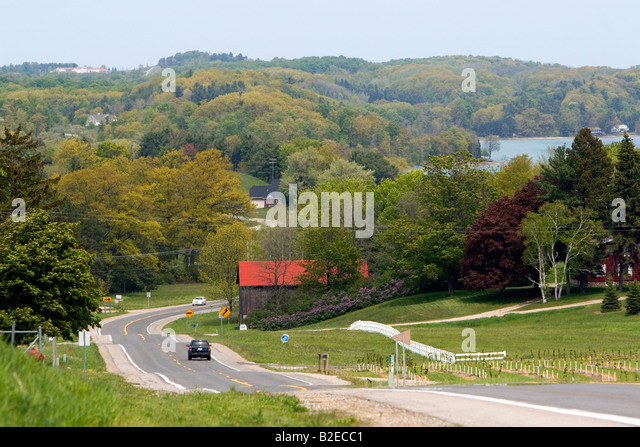 Autos travel on M 37 state highway near Traverse City Michigan - Stock-Bilder