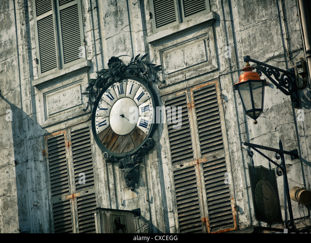 Broken clock in a village near Paris, France - Stock Image