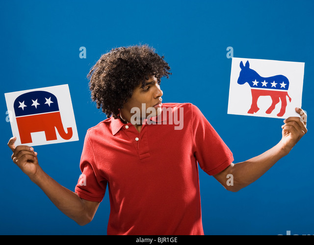 young man choosing between political parties. - Stock Image