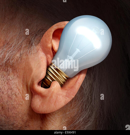 Listen to ideas concept as a lightbulb inside a human ear as a symbol of listening and tuning in to creative thoughts - Stock-Bilder