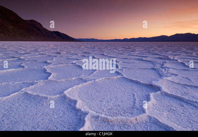 Salt pan polygons at sunset Badwater Basin Death Valley National Park, California, USA - Stock Image