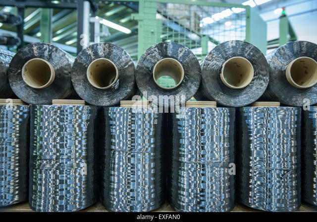 Rows of carbon fibre in carbon fibre factory - Stock Image