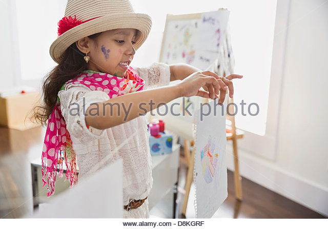 Girl pretending to be artist at home - Stock Image