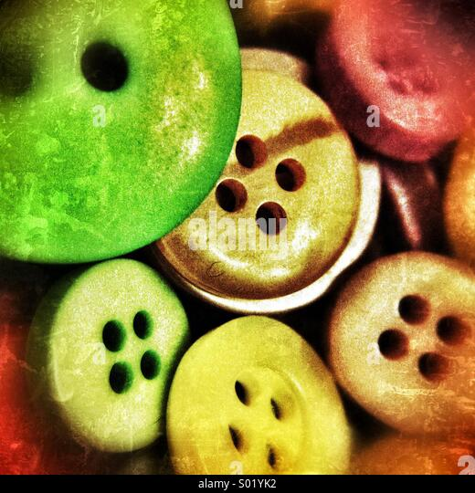 Magnified Buttons (Image taken through a hand lens) - Stock Image