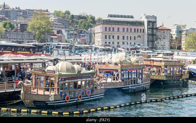Istanbul, Turkey - April 25, 2017: Traditional fast food bobbing boats serving fish sandwiches at Eminonu - Stock Image