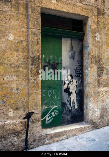 The Gut: wall art in Strait Street, Valletta, capital of the island state of Malta in the Mediterranean sea - Stock Image