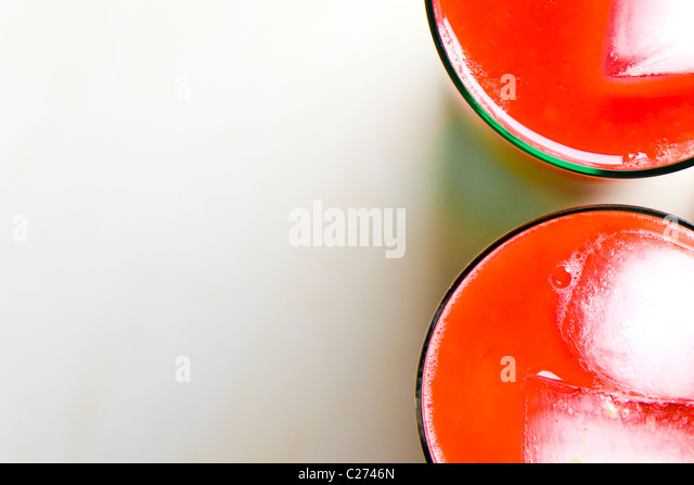 Two Glasses of Tomato Juice with Ice - High angle view - Stock Image