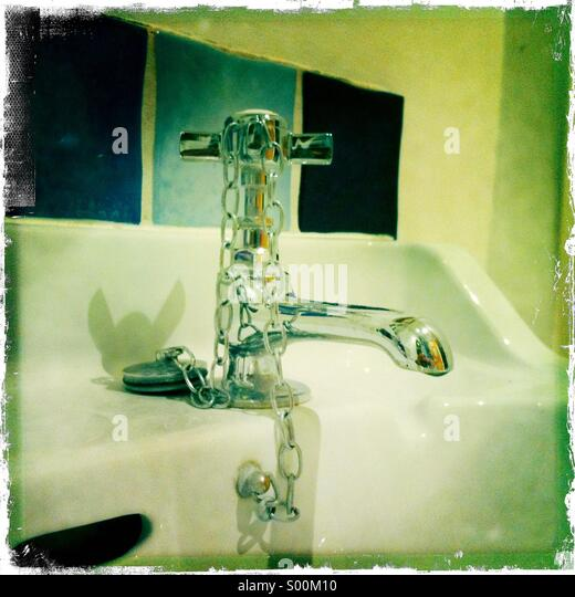 Shiney bathroom tap and wash basin - Stock Image