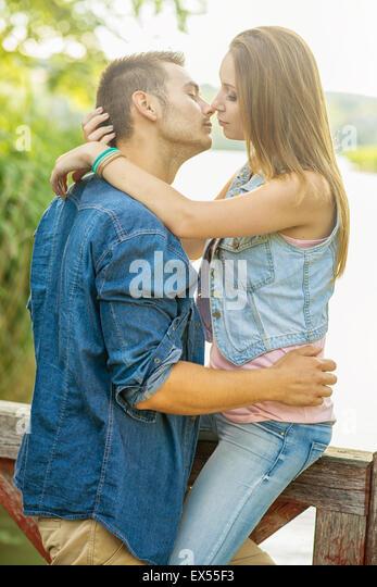 Couple in love on the lake, hug, close-up - Stock-Bilder