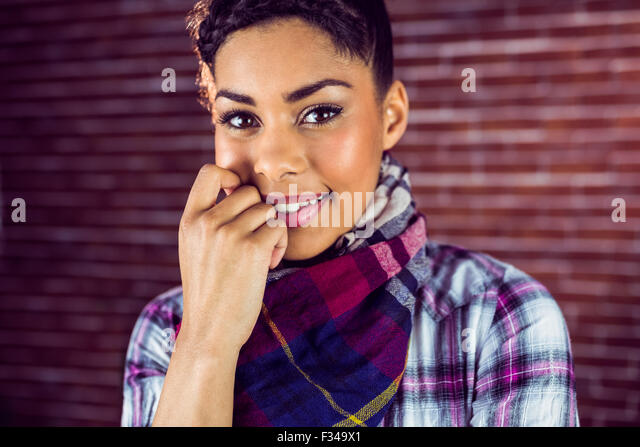 Portrait of a happy shy hipster - Stock Image