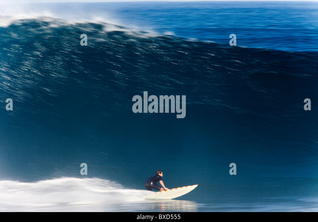 A surfer, captured in Speed Blur fashion at world famous Pipeline, on the north shore of Oahu, Hawaii. - Stock Image