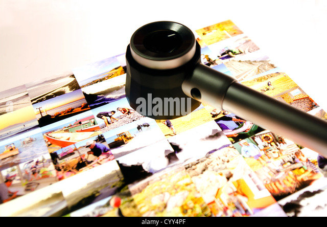 Editing slides on a light table of a newspaper/magazine. - Stock Image