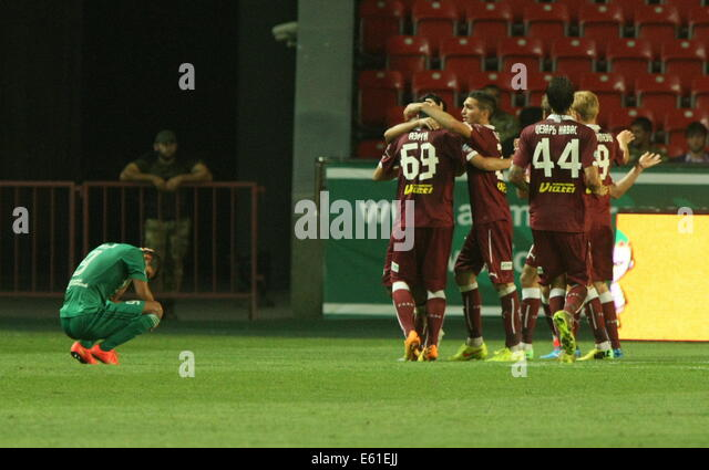Grozny, Chechnya, Russia. 8th Aug, 2014. FC Rubin's players (R) celebrate after scoring an equalizer goal in - Stock-Bilder