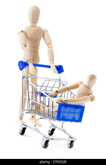 Shopping concept.  One wooden dummy rolls another in the shopping cart. - Stock Image