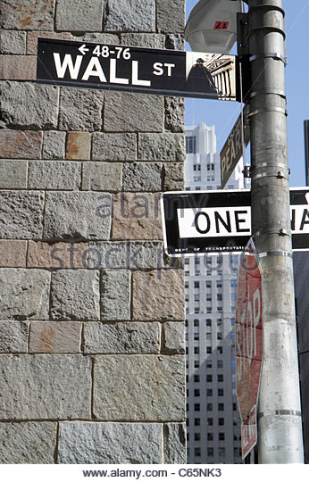 New York New York City NYC Lower Manhattan Financial District FiDi Wall Street street sign stone wall money symbol - Stock Image