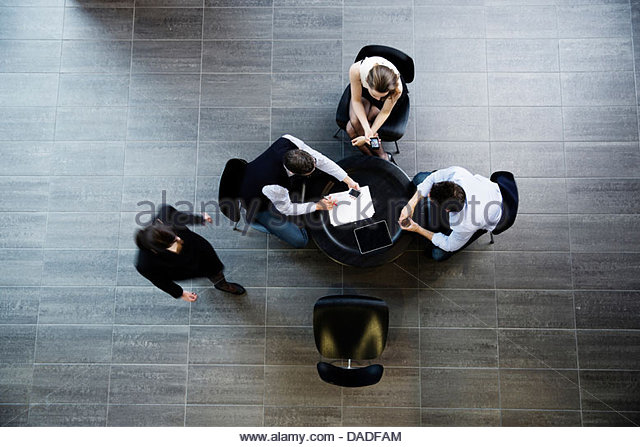 Four people in meeting - Stock Image