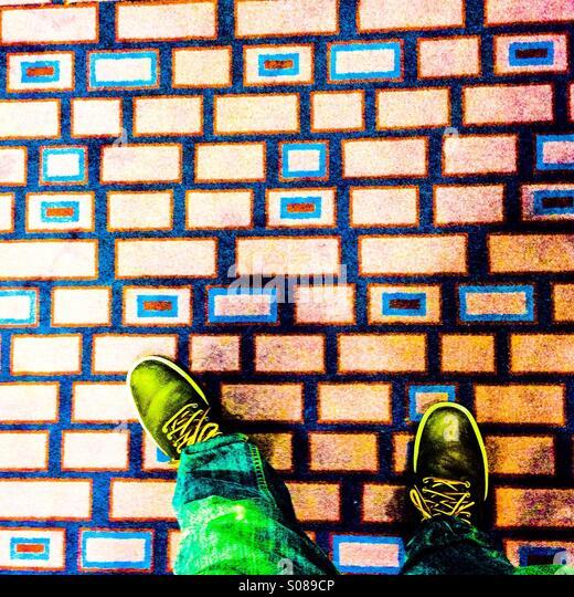Man standing at colorful floor - Stock-Bilder